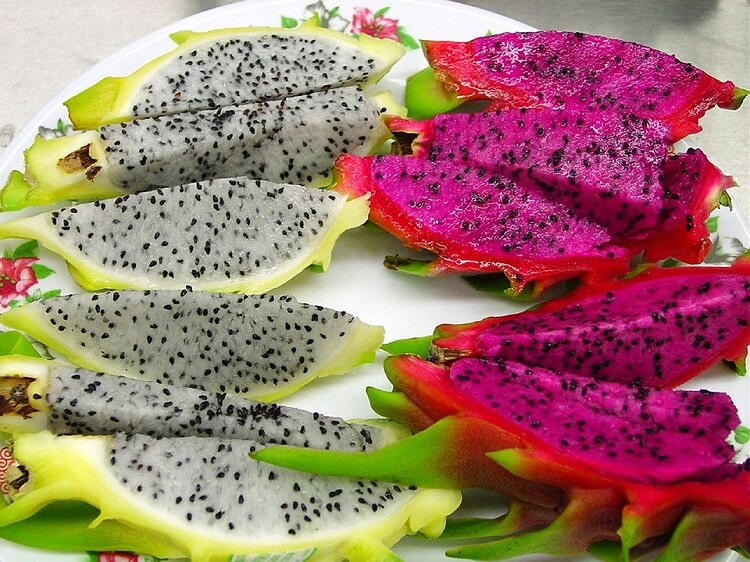 Red and white dragon fruit slices