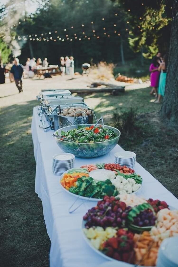 BBQ wedding buffet with bowls and plates of vegetables