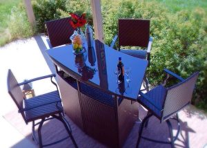 Outdoor bar set from Palmerton Landing with glass top and four chairs