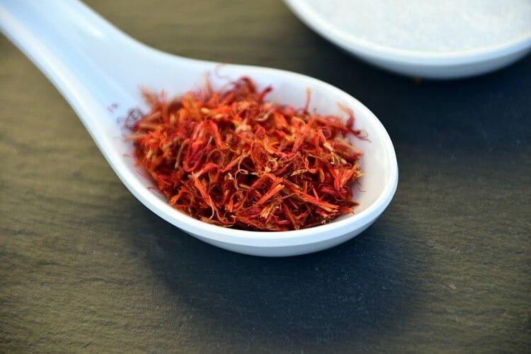 Dry orange saffran in spoon