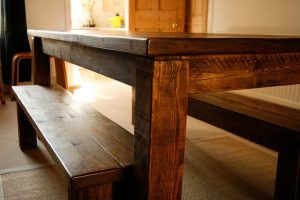 Corner of a brown farmhouse table
