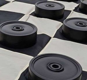 Giant checkers set in black and white