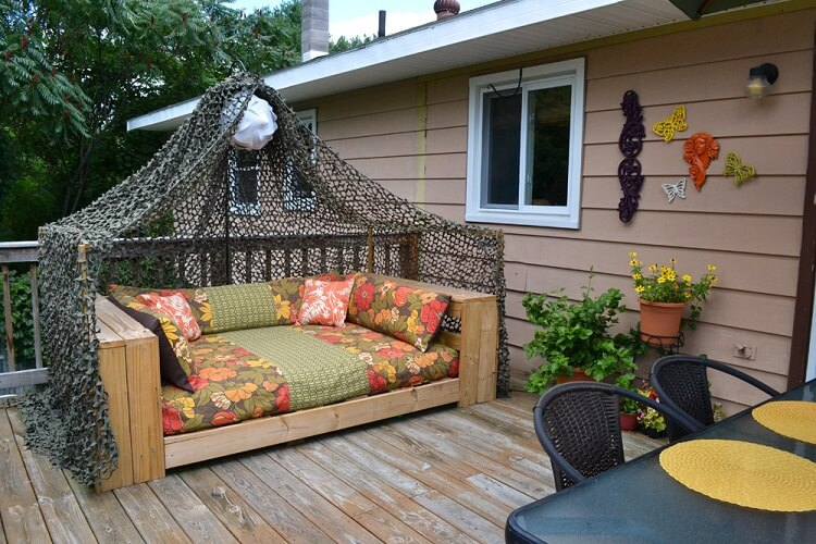 Beige pallet daybed placed in the patio