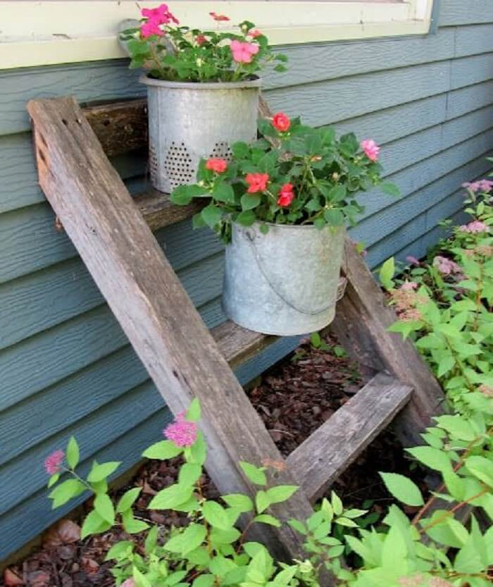 Plant pots support made of railroad ties