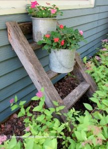 Railroad ties making a support for flower pots