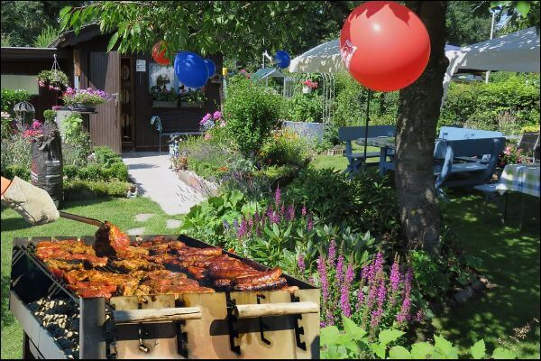 Backyard party with barbecue, balloons