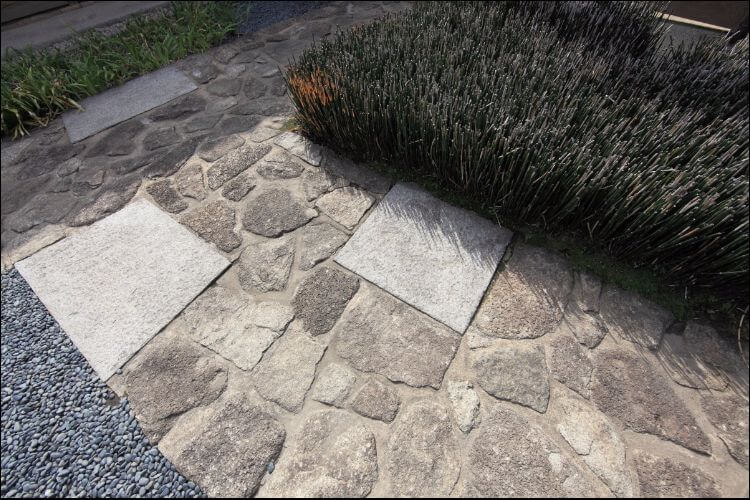 DIY pathway made of stones and concrete pieces