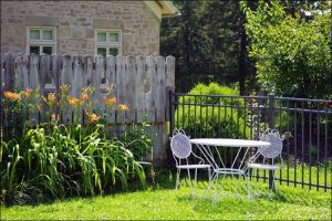 Garden metal chairs and table painted white