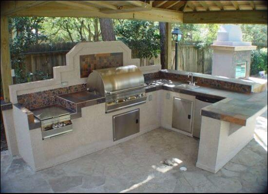 Outdoor kitchen construction with concrete panels and steel stud structure