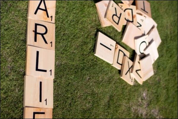 Scrabble with giant pieces of wood