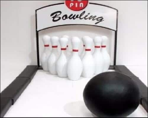 Oversized bowling set with white pins and blue ball