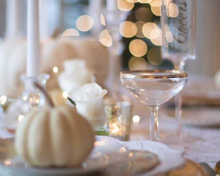 White pumpkin decoration placed on wedding table