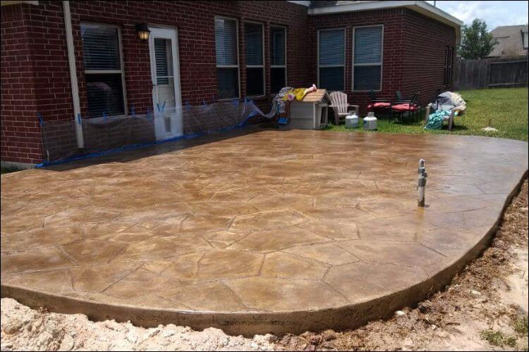 Rounded and raised stained concrete patio