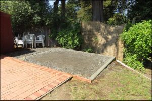 Square concrete patio lined up next to another concrete slab