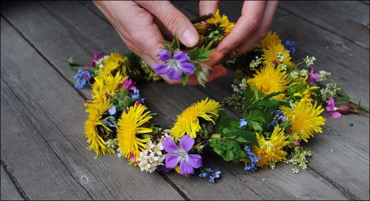 Summer wedding wreath with yellow and purple flowers