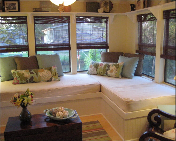 Corner bed placed in a sunroom, sun porch furniture ideas