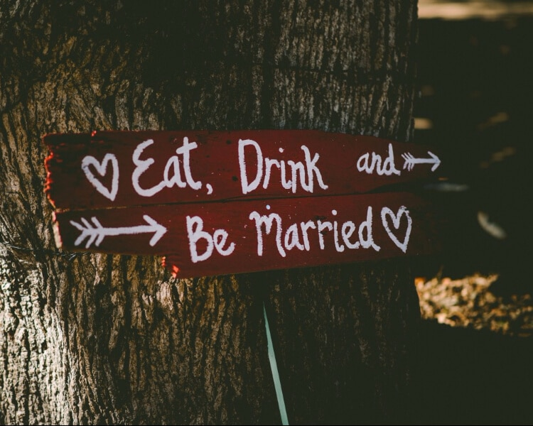 "Wooden sign with ""Eat, Drink and Be Married"" written on it"