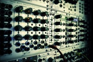 Close up of a modular synthesizer useful for a studio shed