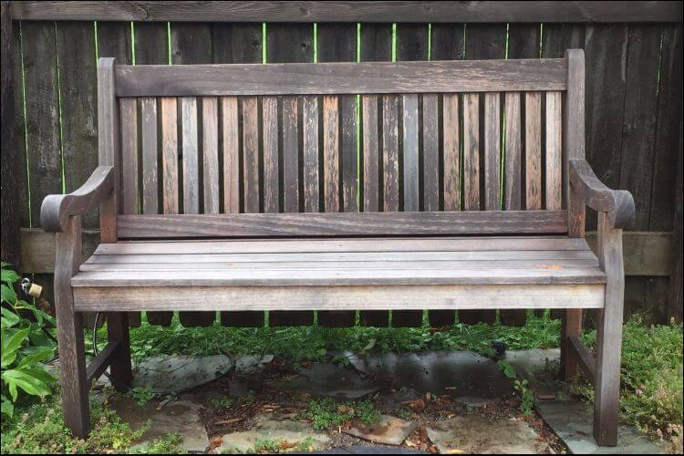 Front view of an old wooden bench with a worn aspect - Complete Guide On How To Waterproof Wood Furniture For Outdoors