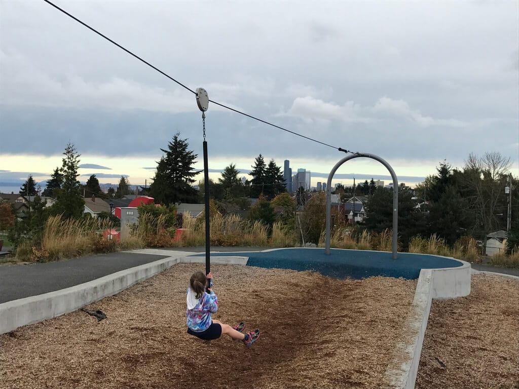 Zipline for children on a playground over a sandbox