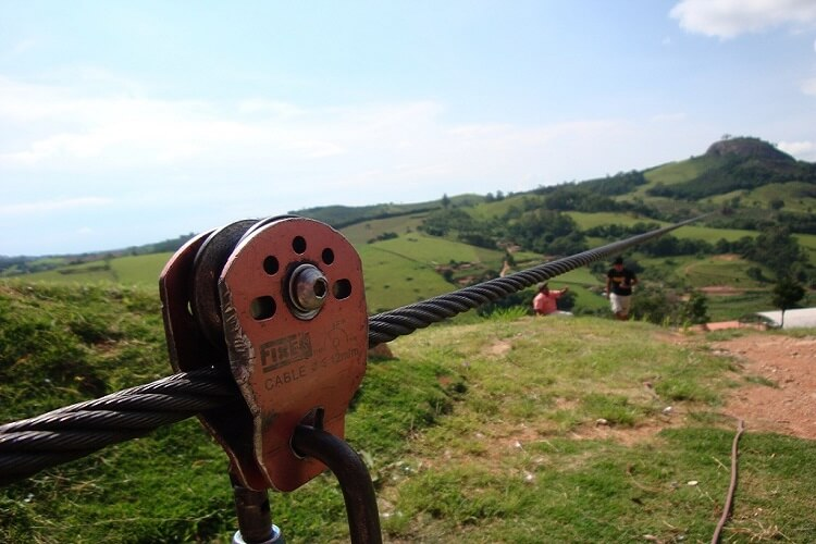 Close up of a zipline pulley set in a hilly area