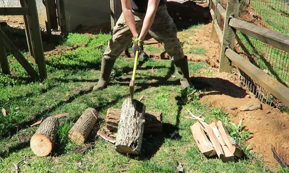 splitting maul axe backyard logs