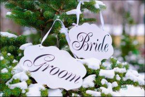 winter wedding ideas bride and groom signs