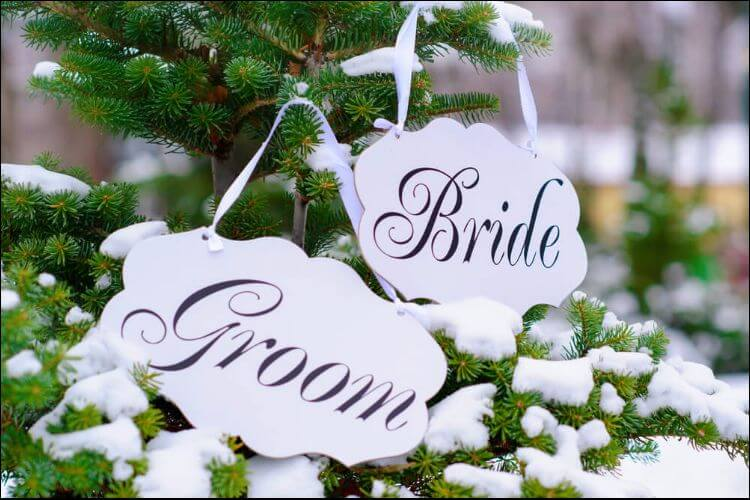 winter wedding ideas bride and groom signs