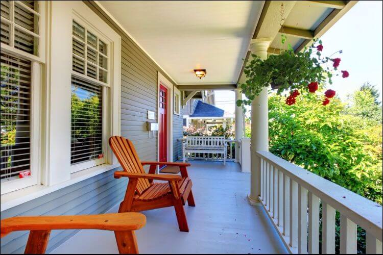 landscaping ideas for front porch white-lined porch with brown chairs