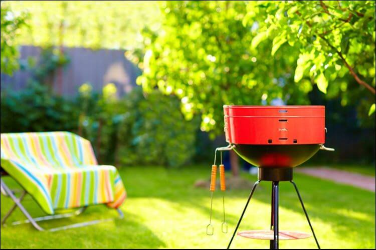 DIY backyard movie screen red grill in the backyard