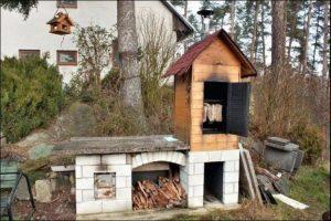 DIY backyard smoker made of wood and cinder