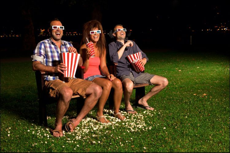 DIY backyard movie screen friends watching movie