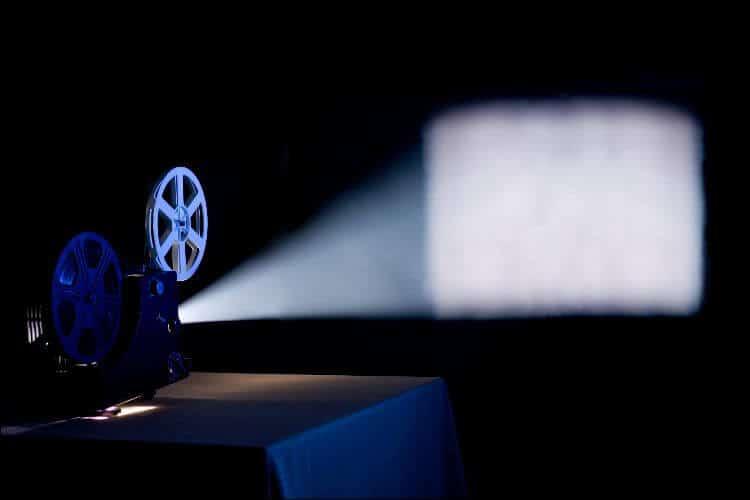 DIY backyard movie screen projector showing movie on a screen
