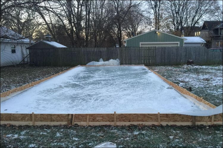 DIY ice rink set up in a backyard