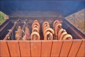 DIY backyard smoker close up of meat hanging in the smoker