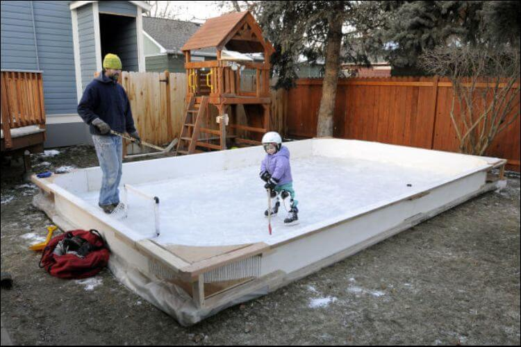 DIY ice rink father and child skating