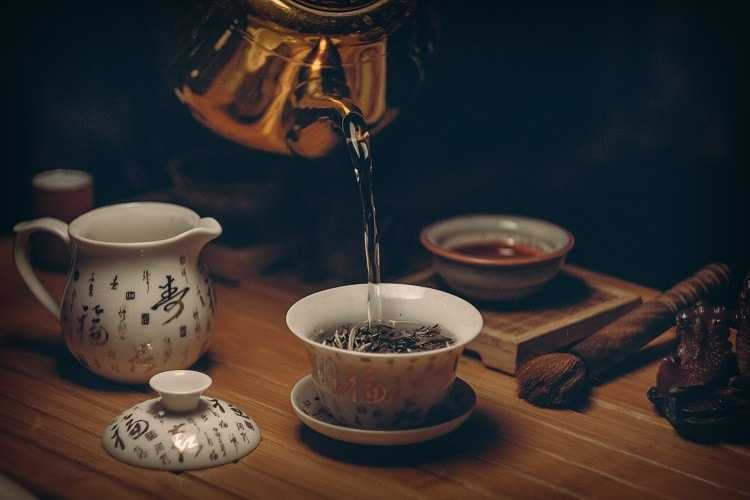 Pouring hot water on tea leaves