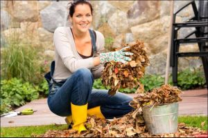 mound gardening woman gathering leaves as organic matter