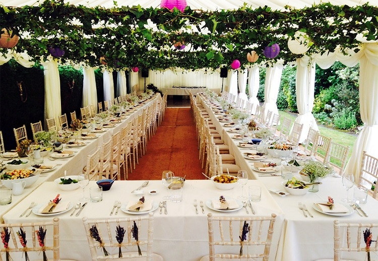 Wedding greenery garlands hanging over tables