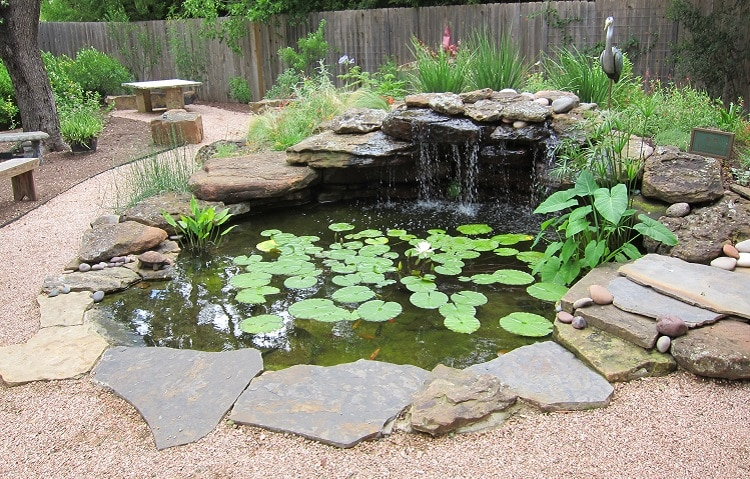 Garden waterfall edged by big river stones
