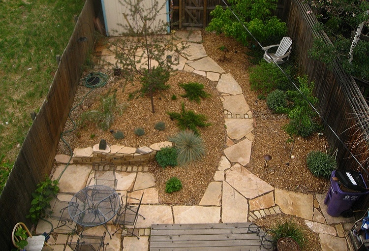 Hardscape and softscape garden with a stone alley and some vegetation