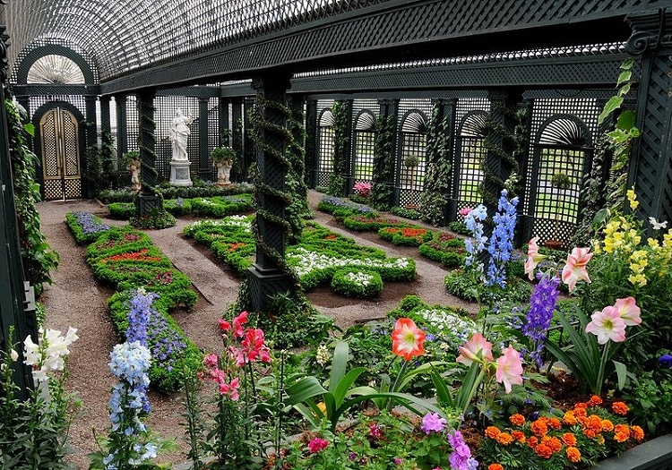 French garden with colorful flowers and plenty of concrete structures
