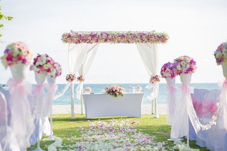 Wedding archway and decorations on the beach, wedding flower wall