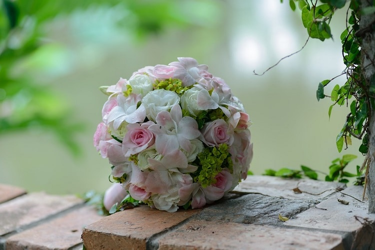 Pink-based bride bouquet with light pink flowers