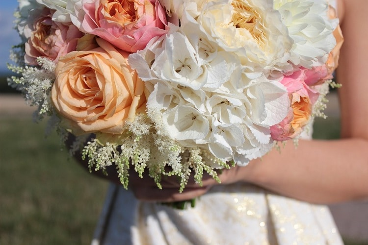 Wedding bouquet made of lightly colored spring flowers