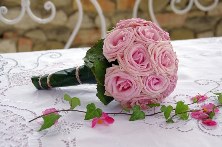 Bridal bouquet with pink roses and green leaves
