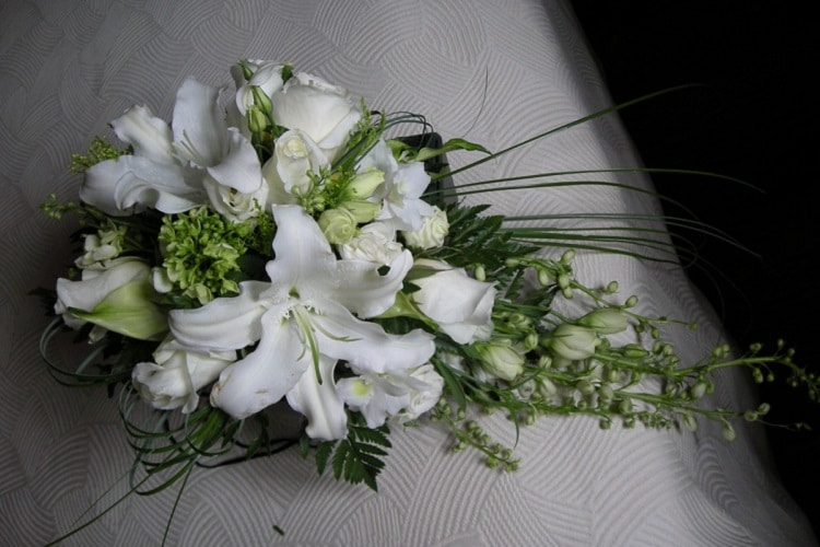 Wedding bouquet containing greenery and white flowers