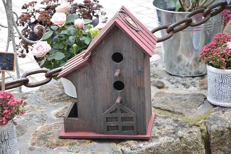 Big fancy birdhouse with red roof