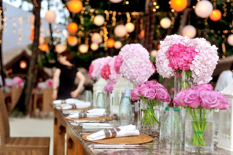 Pink wedding flowers in vases on the table