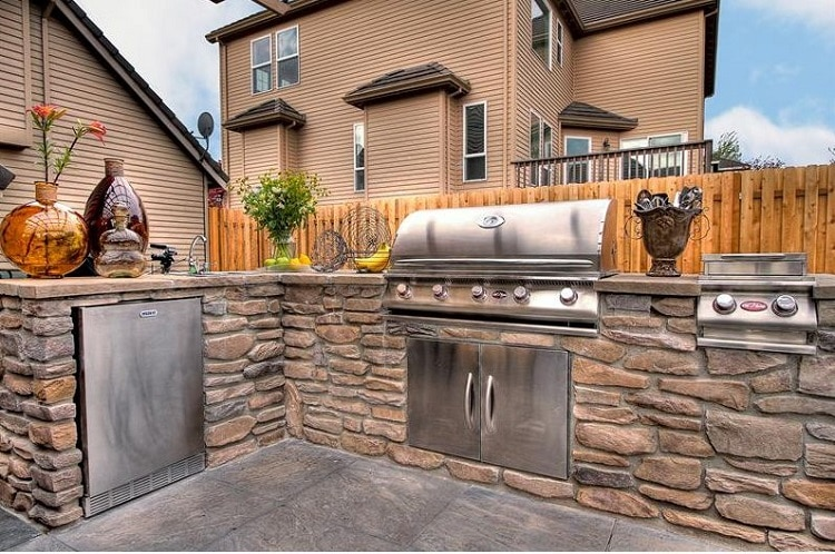 Outdoor kitchen with a custom stone design
